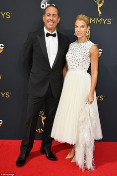 What an entrance: Jerry Seinfeld was beaming big smiles alongside his lovely wife Jessica as he arrived to the Emmys - his first appearance at the TV awards show in 19 years