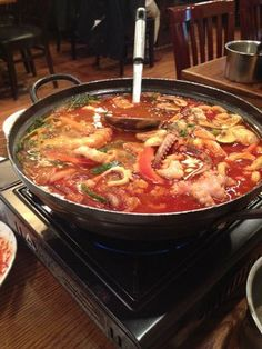 Spicy Seafood Gamjatang with pork bone, octopus, shrimp, mussels, udon and kimchi. Soooo good!