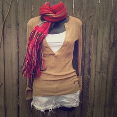 American eagle tan low cut top Perfect condition! Cut is low so I'd wear some kind of tank top underneath. This top allows a colorful scarf or pants! Sleeves can be cuffed or unrolled. 100% cotton. American Eagle Outfitters Tops