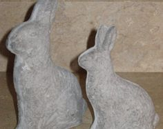 These bunnies are for the artist who likes to paint their own pieces. They are paper mache bunnies I molded from my collection of molds. After the molding and drying stages there are imperfections on the pieces such as air holes and air bubbles. This makes the bunnies more old or vintage looking. He could look smoother by applying filler. I have sanded the seams so he is ready to paint.  Size is approximately: Med Bunny 3 tall, 6 long and 1 1/4 wide Sm Bunny 2 tall, 4 long and 1 wide  Th...