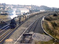January 31st, 1967  Healey Mills  Holbeck's Black 5 44854 on a tanker train overtakes WD 2-8-0 90099 (50D) as it approaches on the adjoining track Ref B3-57