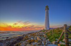 Slangkop Lighthouse at Kommetjie near Cape Town is a great things to do while on a Holiday to Cape Town. We have many Lighthouse along here Cape Town Holidays, Borders And Frames, Holiday Accommodation, Go Camping, Lighthouses, Light In The Dark, South Africa, Things To Do, Places To Visit