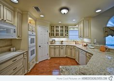 15 Dainty Cream Kitchen Cabinets: I was wondering how white appliances would look with cream cabinets…and here is an example. Not bad!