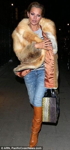 la modella mafia Kate Moss 2013 street style night out chic in fur and stripes 2
