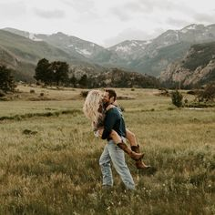 If your boyfriend carries you around like this, marry him. Engagement session in Rocky Mountain National Park, Estes Park, Colorado. Photo by Erika Greene Photography. Click on the photo to see more of my work on Instagram!