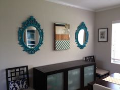 Two Ikea Ung Drill Mirrors, spray painted.  Maybe I can do this, one on each side of the art work?