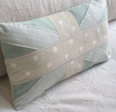 If I had any more room left on my couch i would totally DIY this. Plus I love this duck egg color!