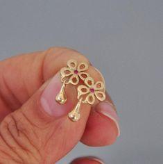 Earrings Studs Tiny Gold Earring Tiny Flower Earring Ruby by malkaravinajewelry Gold Earrings Designs, Gold Jewellery Design, Gold Hoop Earrings, Gold Jewelry, Fine Jewelry, Stud Earrings, India Jewelry, Small Earrings, Chandelier Earrings