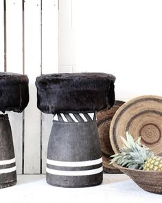 Village - Stomping Ground Up-cycled African grain stompers as pod stools, using full grade goat hide upholstery. ••• Featured: Tribal Grain Stomper & Goat-hide Cushion.