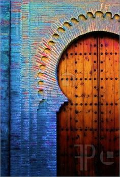 Gorgeous Moorish Wooden Door With Colorful Hues Transcending Above.