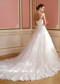 217210 Nellie - Sleeveless tulle and organza over satin ball gown with wide tapered lace straps, sweetheart bodice adorned with sequin embroidered Alencon lace appliqués, dropped waist, scooped back with covered button closures, sequin lace scalloped hemline, chapel length train.