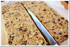 grain free granola bars 2.5 cups assorted nuts and seeds 1 cup dried fruit 2 cups shredded coconut 1/4 cup coconut oil 1/2 cup honey splash of vanilla extract 1/2 teaspoon salt generous sprinkle of cinnamon some more cinnamon