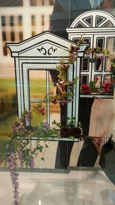 Window display with flowers- what a sweet idea..we could hang jewellery from the windows Handmade - Home & Kitchen - Furniture - handmade furniture - http://amzn.to/2ksLfE7