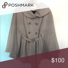 Calvin Klein Wool Cape Tan with chocolate brown lining. Size S/M. Fits oversized. Shell made of 60% wool, 35% polyester, 5% other. Lining is 100% polyester. Professional dry clean only. Calvin Klein Jackets & Coats Capes