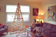 A Jubiltree Wood Christmas Tree decorated with all natural ornaments--cranberry and popcorn garland, dried orange slices, salt dough ornaments, pinecones, and cinnamon applesauce ornaments.   The Jubiltree Company, LLC    Modern Wood Christmas Trees