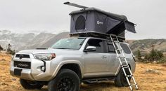 The OverRoam Roof Top Tent from Denver Outfitters on top of a Toyota 4Runner in a scenic mountain shot.