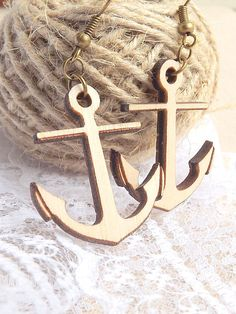 """Anchor Earrings made from wood.  * Dimension: anchor diameter 2.5cm / 1"""", lenght 3cm / 1.2"""", thickness 3mm / 0.11"""". Total earring lenght with hook is about 5cm / 2"""". * Materials: wood, antique bronze earring hook (if you need with silver plated hooks, please contact with me). * It will come nicely gift wrapped."""