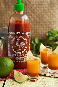 Sriracha Mango Cocktail Shots | 3/4 cup ripe mango puree  1/3 cup corn syrup  1/4 cup whiskey   juice of 1 lime  2 cups ice cubes    1/2 – 1 tsp Sriracha