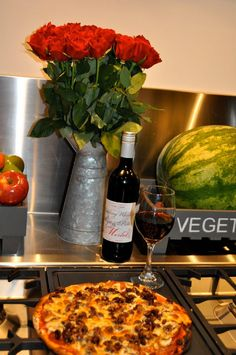 Home made pizza from fresh country produce with home grown roses and amazing bottle of merlot!