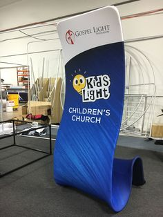 """The """"S"""" shaped stand-up banner gets noticed. It's lightweight, portable and snaps together; no tools required. Just pull the fabric graphic over the top and zip at th bottom. Perfect for Kids Ministry."""