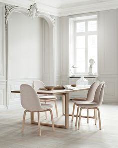 #DiningRoom with beautiful #WallPaneling & #Scandinavian style chairs and table.