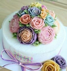 Butter Cream Cake with a bouquet  of variegated color roses on top.
