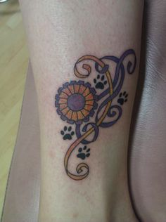 My new tattoo, three days old. I show Pug dogs, and this tattoo in on my left ankle represents my dedication to being a responsible owner, breeder, and handler. Pugs will always walk with me, and the purple and gold ribbon with the rosette represent a Best Of Breed AKC show ribbon.     Dogs are the best people. They never judge you, or have a harsh word to say. They are my daily inspiration. #dog #tattoo #showdog #AKC