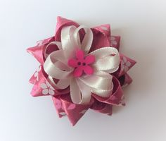 Double pointed star bow with flower centre Barrette Clip, Flower Center, Centre, Bows, Stars, Flowers, Gifts, Ticks, Arches