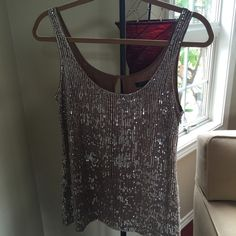 Jcrew sequin top in taupe A nice dress me up and down sequin top, cute with jeans , skirts etc... Used only a few times, it's in very good condition. J.Crew Factory Tops