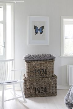 simple wall decor...so pretty and love those numbered baskets too.