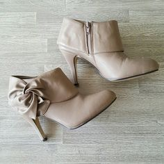 Taupe Bootie Heels Very nice pair of booties. Gently used and well taken care of, slight signs of wear are as pictured. Nothing major or noticeable when wearing! Shoes Ankle Boots & Booties