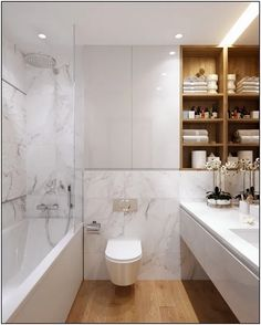 Bathroom decor for your master bathroom renovation. Learn bathroom organization, bathroom decor tips, bathroom tile ideas, master bathroom paint colors, and more. Modern Marble Bathroom, Diy Bathroom, Budget Bathroom, Bathroom Layout, Modern Bathroom Design, Bathroom Interior Design, Bathroom Faucets, Bathroom Storage, Small Bathroom