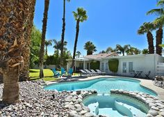 Our 3-bed, 2-bath Palm Springs house on a quiet cul-de-sac will make you feel right at home—right away! Drop your bags in one of the 3 bedrooms, change into your bathing suit, and head out to the private, mountain-view outdoor area. Tall palms shade the lagoon-style pool and lush landscaping creates lots of privacy. - Turnkey Vacation Rental Palm Springs Vacation Rentals, Mountain View, Palms, Lush, Bathing, Landscaping, Bedrooms, Shades, Change