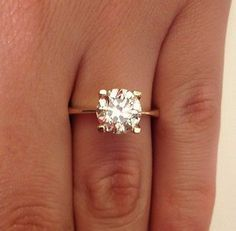 2 ct. ring with dainty band -- love how thin the band is, love the simplicity of the ring.