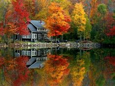 Such a pretty home and lake, beautiful reflection of the trees. Love to have as a week end get away   It's Written on the Wall: {Gotta See} Amazing Photos of Fall Scenery-So Many Colors