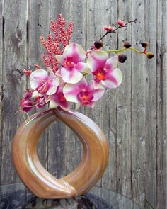 Orchid Arrangements - Pink Orchid Floral Arrangement Contemporary Circle Vase. $25.00, via Etsy.