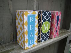 I should have thought of this... blocks of wood + scrap paper + mod podge = bookends