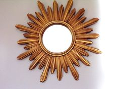 Sunburst mirror vintage 1960 Eye witch, flat mirror shaped sun very good state no breaks, no defects on branches mirror in perfect condition the must