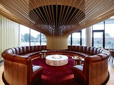 Design Detail – An Eye-Catching Circular Fireplace Stands Out In This Hotel Bar