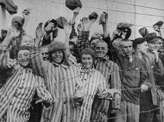 Survivors at Dachau Concentration Camp wave to the liberators.  Amazing.  Just look at the joy on their faces.