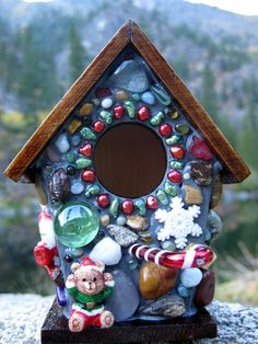 Christmas Birdhouse with Candy Canes and Snow Flakes,This little birdhouse has Christmas all over it. Coastal agates, rocks and glass beads done in mosaic.