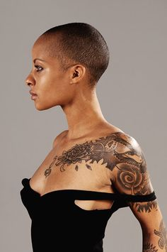 While the mainstream media has created a womanly image that many women try to follow, we are starting to see the emergence of a sub-culture that identifies beauty with individualism or braving outside the norm. Here a woman with a shaved head and tattoos is posed in a manner that makes her look strong and independent.