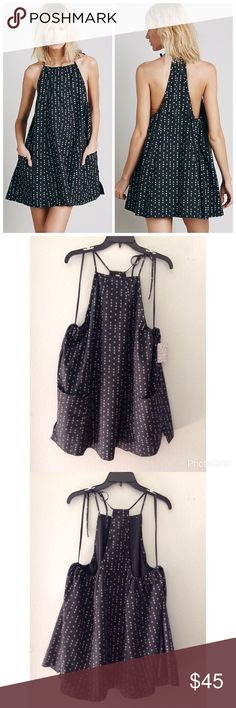 Free people Everlong dress Free people Everlong dress... Swingy printed mini dress with an apron silhouette and hip pockets. Ties at the neck. 100% Cotton. Measurements: Bust: 30 in = 76 1/4 cm Length: 30 1/4 in = 76 3/4 cm. Color: black Free People Dresses