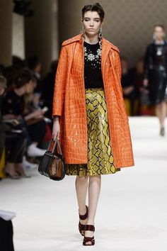 Miuccia's vibrant coat and printed skirt are a textural dream—the ultimate in statement outerwear.