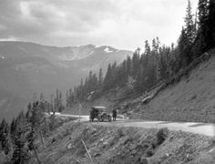 """* * """"Guardrails? Who Needs Guardrails?"""" * *  1920's motorist pause to take in the view on Berthoud Pass"""