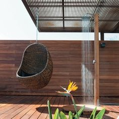 I love serene outside showers!  Plus the little hanging egg chair looks so relaxing. Outdoor Baths, Indoor Outdoor, Outdoor Living, Outdoor Decor, Hanging Hammock Chair, Hanging Chairs, Garden Shower, Teca, Shower Tub