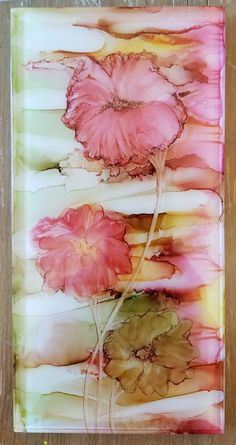 Soft petal flowers in alcohol ink on 8x4 glass tile. By Tina