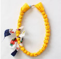 Fabric-Covered Necklace: Maybe this would work well with hemp or burlap?