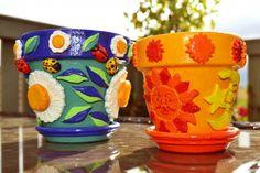 Painted terracotta plant pots