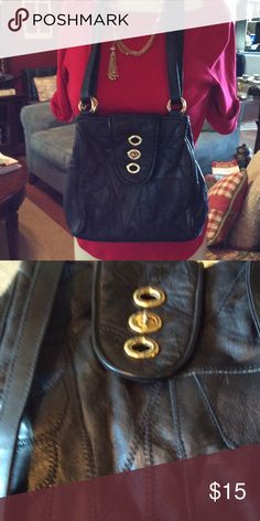 Cute Black Purse! Faux Leather Appeal. Great size with fashion closing and gold toned rings on each side holding double strap. Great condition. No tears inside or out! Bags Shoulder Bags